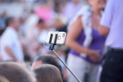 Selfie remote control on cellular phone Royalty Free Stock Image