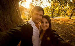 Selfie of romantic couple at autumn park at sunset Stock Photography