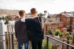 Selfie rooftop friends share youth bff lifestyle stock image