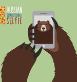 Selfie in Russia. Bear selfie. Bear paw holding a phone. Russian Stock Image