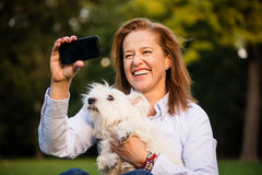 Selfie - senior woman and dog Royalty Free Stock Image