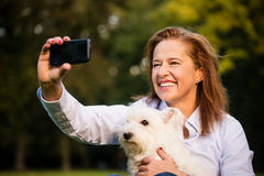 Selfie - senior woman and dog Royalty Free Stock Photos