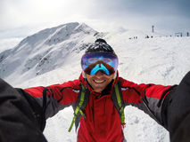 Selfie of skier on the top of the mountain Stock Image