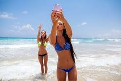 Selfie smartphone girls beach Royalty Free Stock Image