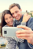 Selfie smartphone self-portrait by happy couple. Royalty Free Stock Image