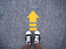 Selfie Sneaker Black Shoes On Concrete Road With Yellow Arrow Li Stock Photos
