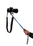 Selfie stick. An Selfie stick with an adjustable clampon a white background stock image