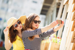 Selfie on the street for two beautiful women. Royalty Free Stock Image