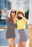 Selfie on the street for two beautiful women. Stock Photo
