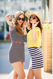 Selfie on the street for two beautiful women. Royalty Free Stock Images