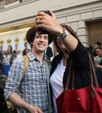 Selfie with T.R. Knight. A fan takes a selfie with actor T.R. Knight, who acts in the Broadway play, It's Only A Play in Royalty Free Stock Photo