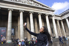 Selfie. Taking selfie in front of british museum Stock Photography