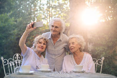 Selfie during teatime. Old ladies are taking a selfie during teatime Royalty Free Stock Photo