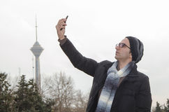 Selfie in Tehran. A young man taking a selfie in Iran capital Stock Images