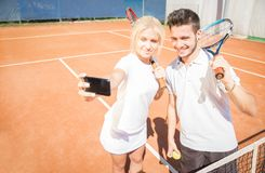 Selfie on a tennis court Stock Photos
