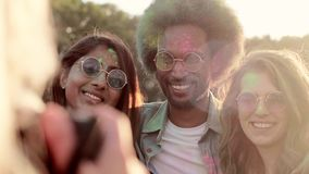 Selfie of three best friends. At the holi festival stock video footage