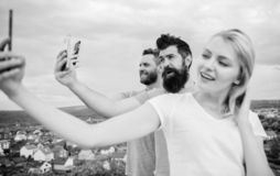 Selfie time. Life online. People taking selfie or streaming video. Mobile internet social networks. Mobile dependency. Problem. Bloggers team. Girl and men with stock photos
