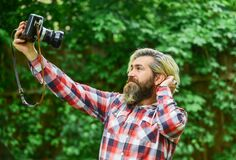 Free Selfie Time. Vintage Camera. Capture These Memories. SLR Camera. Hipster Man With Beard Use Professional Camera Royalty Free Stock Photography - 198432537