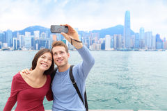 Selfie tourist couple taking picture in Hong Kong Royalty Free Stock Photos