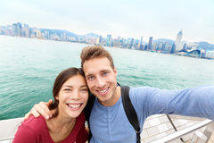 Selfie - Tourists couple taking picture Hong Kong royalty free stock photography