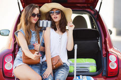 Selfie two girlfriends in the trunk of a car Stock Photography