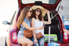 Selfie two girlfriends in the trunk of a car Royalty Free Stock Photography