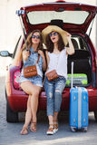 Selfie two girlfriends in the trunk of a car Stock Images
