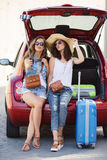 Selfie two girlfriends in the trunk of a car Stock Photo