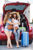 Selfie two girlfriends in the trunk of a car Royalty Free Stock Photos