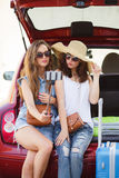 Selfie two girlfriends in the trunk of a car Stock Image