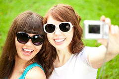 Selfie. Two young trendy girls doing selfie. A couple of friends Stock Photo