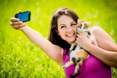 Selfie woman and cat Stock Photos