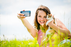Selfie woman and cat Stock Images