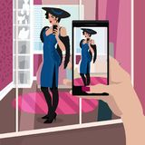Selfie woman in evening dress. First person view of woman is defiantly dressed in evening dress in dressing room, take selfie photo on smartphone. Expressive Royalty Free Stock Photography