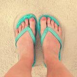Selfie of woman feet wearing flip flops on a beach Stock Photography