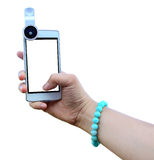 Selfie with woman holding smartphone stick fisheye lens with self portrait picture Stock Photography