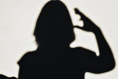Selfie woman silhouette salutes Stock Images