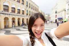 Selfie woman taking fun selfportrait in Macau Royalty Free Stock Image