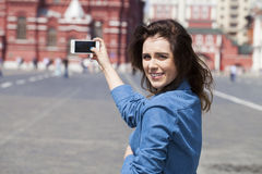 Selfie, Young beautiful girl photographed on a cell phone Stock Photos