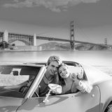 Selfie of young couple convertible car Golden Gate Stock Images