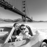 Selfie of young couple convertible car Golden Gate Stock Image