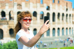 Selfie of a young female tourist on the background of the Coloss Stock Photos