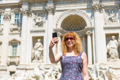 Selfie of a young female tourist near the Trevi Fountain Royalty Free Stock Image