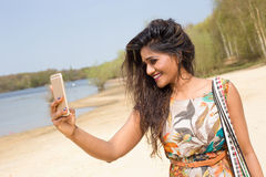 Selfie. Young indian woman taking a selfie royalty free stock image