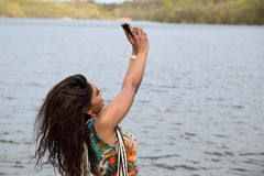 Selfie. Young indian woman taking a selfie royalty free stock photo