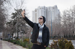 Selfie. A young man taking a selfie Royalty Free Stock Images