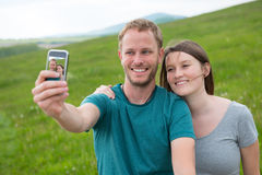 Selfie. Young men and women making taking a self-portrait Royalty Free Stock Image