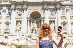 Selfie of a young tourist near the Trevi Fountain Royalty Free Stock Photos