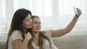 Selfie youth lifestyle friends leisure girls photo. Selfie modern youth lifestyle. online posting social network concept. friends leisure. young girls taking stock footage