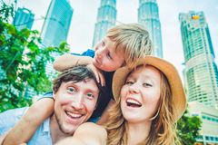Selfies family on the background of skyscrapers. tourism, travel, people, leisure and technology concept.  stock photo